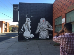 Geloy Concepcion photographing the completed mural outside of James Makin Gallery, Collingwood, Melbourne.